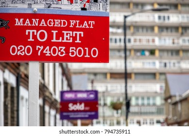 London, UK - December 9, 2017 - TO LET sign displayed on London street with a council tower block in the background
