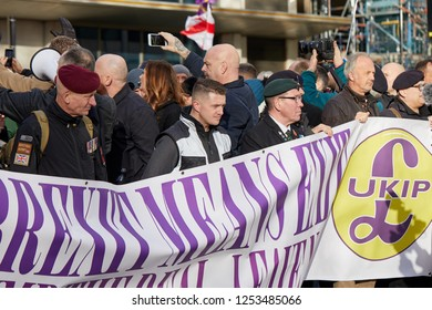 London, UK. - December 9, 2018: Tommy Robinson, joined by army vetrans on the Brexit Betrayal March and Rally.