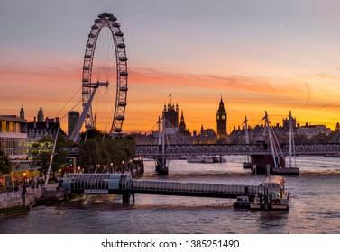 London, UK, England: 11/2/2016  Millenium Wheel dominates South Bank and Big Ben skyline at sunset