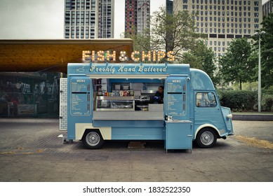 London, UK England - APRIL 27 2019: Traditional fish & chips van at Southbank. Mobile food truck selling freshly hand buttered cod fish and chips outdoors.