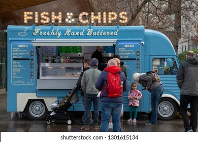 London, UK England - January 25 2019: Traditional fish & chips van at Southbank. Mobile food truck selling freshly hand buttered cod fish and chips outdoors.