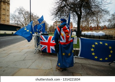 London, UK - Feb 11, 2019: Man draped in both an EU and British flags protests against Brexit outside Westminster, London, UK