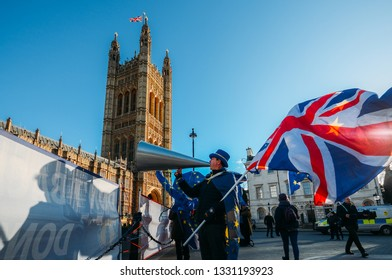 London, UK - Feb 11, 2019: STEVE BRAY, founder of SODOM, carrying both a British and EU flag protests against Brexit outside Westminster London UK