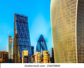 LONDON, UK - FEB 15, 2015: Cheesegrater, Gherkin and Walkie Talkie Buildings, on February 15, 2015 in London, England. Gherkin is 180 meters tall and stands in the City of London Financial District.