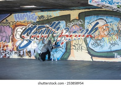 LONDON, UK - FEB 2015 - London Southbank Skate park as a graffiti artist finishes off latest design