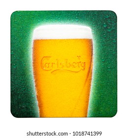 LONDON, UK - FEBRUARY 04, 2018: Carlsberg 1664 Beer beermat coaster isolated on white background