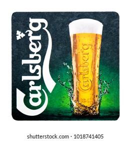 LONDON, UK - FEBRUARY 04, 2018: Carlsberg 1664 Beer beermat coaster isolated on white background