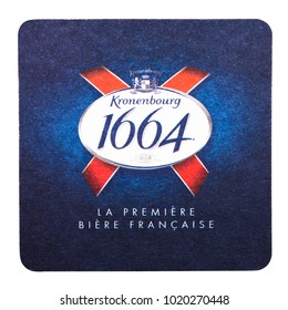 LONDON, UK - FEBRUARY 04, 2018: Kronenbourg 1664 Beer beermat coaster isolated on white background