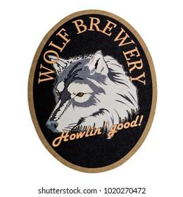 LONDON, UK - FEBRUARY 04, 2018: Wolf Brewery beermat coaster isolated on white background