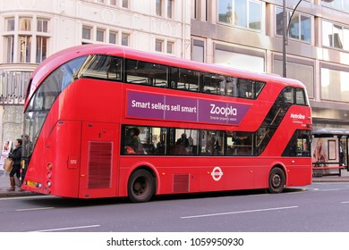 London, UK - February 08, 2015: New hybrid diesel-electric double decker bus full with passengers inside traditionally used for mass public transport in London first introduced in 2012.