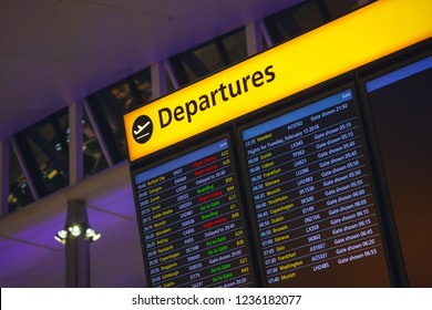 London, UK - February 12, 2018 - Departure board displaying time, destination cities and gate information