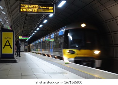 London, UK - February 12, 2018: A Heathrow Express train arrives at a station in Heathrow Airport's terminal 2.