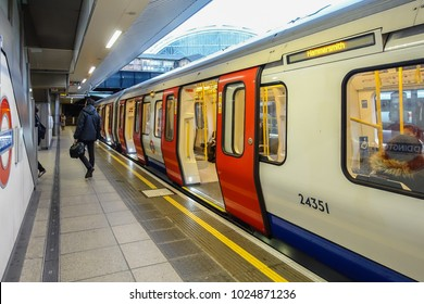 LONDON, UK - February 13, 2018: A London Underground train sits at the platform at Paddington Station with it's doors open.