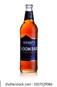 LONDON, UK - FEBRUARY 14, 2018: Cold bottle of Sharp's Doom Bar amber ale on white background with dew.
