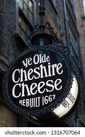 London, UK - February 15th 2019: Pub sign at the historic Ye Olde Cheshire Cheese public house, on Fleet Street in the London. The pub is associated with Charles Dickens, GK Chesterton and Mark Twain.