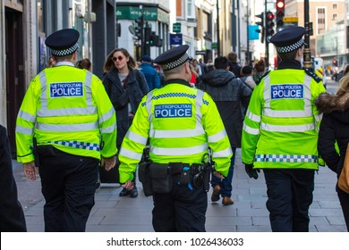 LONDON, UK - FEBRUARY 16TH 2018: Metropolitan Police Officers walking down Oxford Street in central London, on 16th February 2018.