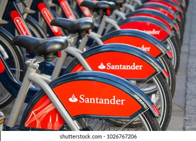 LONDON, UK - FEBRUARY 16TH 2018: Close-up of the Santander bank logos on a row of Santander Bicycles - a public cycle hire scheme in London - taken on 16th February 2018.