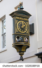 LONDON, UK - FEBRUARY 16TH 2018: The clock above the entrance to Pied Bull Yard, located in the Bloomsbury area of central London, UK, on 16th February 2018.