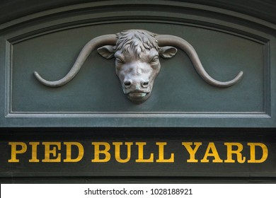 LONDON, UK - FEBRUARY 16TH 2018: Detail of the entrance to Pied Bull Yard, located in the Bloomsbury area of central London, UK, on 16th February 2018.