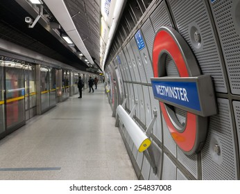 LONDON, UK - February 17, 2014: Picture showing passengers waiting to board underground train at Westminster Station