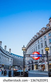 LONDON, UK FEBRUARY 17TH, 2019 - View of Regent Street and the entrance of Piccadilly tube station with copy space in the sky.