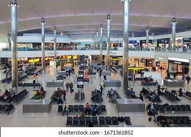 London, UK - February 2, 2018: Air travellers gather at duty free area in the departures hall of Terminal 5 at Heathrow Airport. Heathrow is Europe's busiest airport by passenger traffic.