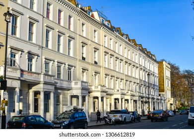 London, UK - February 2 2019: Street view of Lupus street, Pimlico, traditional white townhouses, early evening sun -Image