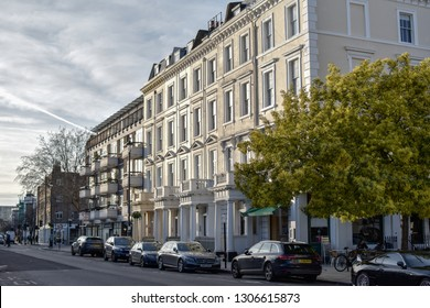 London, UK - February 2 2019: Street view of Lupus street, Pimlico, traditional white townhouses, early evening sun, interesting sky -Image
