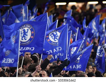 LONDON, UK - FEBRUARY 20, 2018: Chelsea fans with flagspictured during the first leg of the UEFA Champions League last 16 round match between Chelsea FC and FC Barcelona at Stamford Bridge.