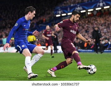 LONDON, UK - FEBRUARY 20, 2018: Andreas Christensen and Luis Suarez pictured during the UEFA Champions League last 16 round match between Chelsea FC and FC Barcelona at Stamford Bridge.