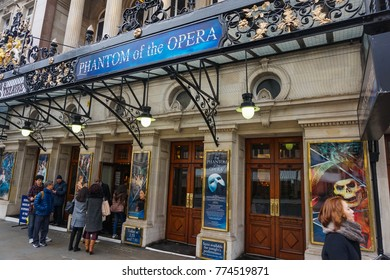 LONDON, UK - FEBRUARY 2017: People walk past Her Majesty's Theatre in the West End. The long running Phantom of the Opera had its world premiere at the theatre in 1986, which itself opened in 1705.