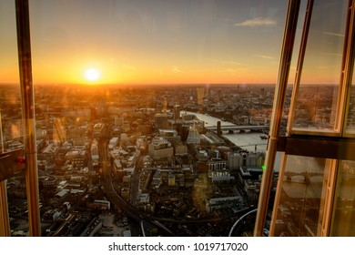 London, UK - February 2018. Sunset view over the city centre from the viewing platform on top of the Shard, the tallest building in Western Europe.