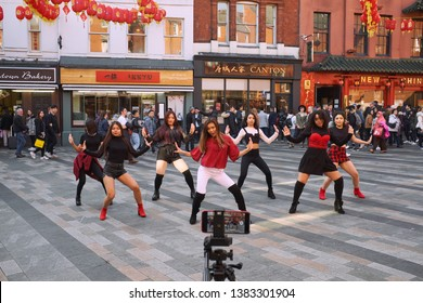 London / UK - February 2019: A K-Pop band films a video in Chinatown, London.
