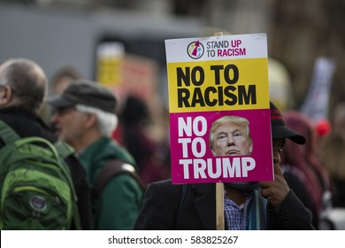 LONDON, UK - FEBRUARY 20th 2017: Protesters hold posters and banners at an anti Donald Trump protest in Parliament square, London.