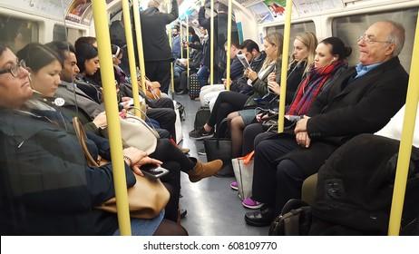LONDON, UK - FEBRUARY 22 2017: people inside subway in London city Undergeound, United Kingdom