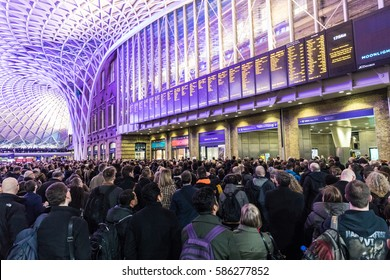 LONDON, UK - FEBRUARY 23, 2017: Crowded Kings Cross station in the city. Hundreds people waiting for the train, with delays and cancellations as Storm Doris lashes UK