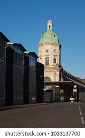 LONDON, UK - FEBRUARY 25, 2018: the Smithfield Market building, designed by Sir Horace Jones, in bright sunlight; in the foreground, the newer Smithfield Poultry Market building is visible.
