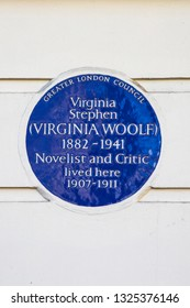London, UK - February 26th 2019: A blue plaque on Fitzroy Square in London, marking the location where novelist Virginia Woolf once lived.