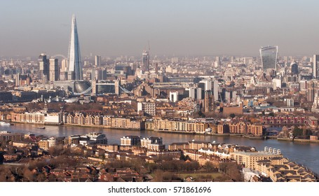 London, UK - February 27, 2015: The River Thames meanders through Rotherhithe and Wapping in London's East End, with skyline landmarks in the distance, viewed from a Docklands skyscraper.