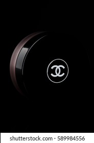 LONDON, UK - FEBRUARY 28, 2017 Chanel face cream container with black logo. On black background with reflection