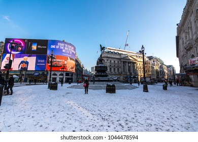 London, UK - February 28, 2018: Clear morning skies after an overnight snow storm turning picadilly circus white