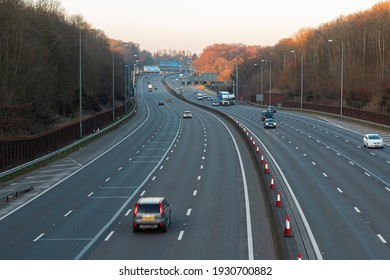 LONDON, UK - FEBRUARY 28. 2021: Evening low traffic on busiest British motorway M25. British road transport