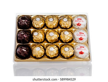 LONDON, UK - FEBRUARY 28, Ferrero Collection Rocher premium chocolate sweets plastic box.On white background with reflection.