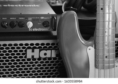 London, UK / February 2nd 2020 : Fender Precision electric bass guitar leaning against TC Electronic amplifier and Hartke speaker cabinet.