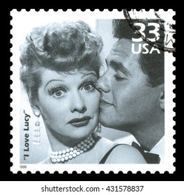 London, UK, February 5 2012 - Vintage 1999 United States of America cancelled postage stamp showing a clip of Lucille Ball and Desi Arnez from the popular television sitcom I Love Lucy
