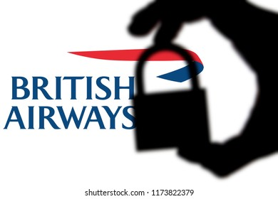 LONDON, UK - FEBRUARY 5th 2018: British Airways security issues. Silhouette of a hand holding a padlock infront of the British Airways logo