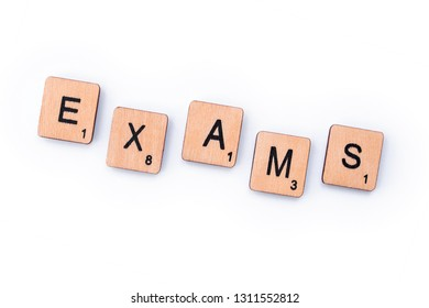 London, UK - February 6th 2019: The word EXAMS, spelt with wooden letter tiles.