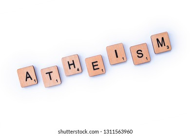 London, UK - February 6th 2019: The word ATHEISM, spelt with wooden letter tiles.