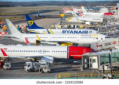 LONDON, UK - FEBRUARY 7, 2019: Airplanes at the gates at London Gatwick airport. Norwegian, Vueling, Ryanair, British Airways and other companies