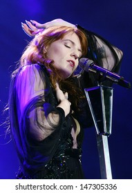 London. UK.  Florence Welch of Florence And The Machine performing live at the O2 Arena in London. December 05, 2012.